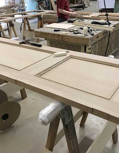 White-Oak-Flat-Panel-Door-with-Custom-Bed-Mould